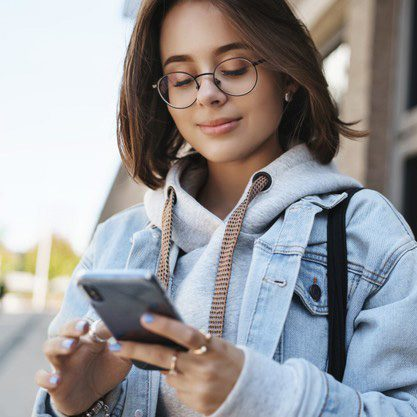 close-up-portrait-tender-romantic-girlfriend-send-cheerful-message-heart-emoji-friend-holding-mobile-phone-smiling-display-texting-with-friend-communicating-while-standing-street_197531-22153-circle